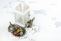 Arabic lantern, dates, aladdin lamp and rosary on white background. Ramadan kareem greeting card. Copy space stock photo