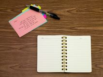 Arabic; Learning New Language Writing Words on the Notebook.  Royalty Free Stock Photos