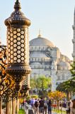 Arabic light with Blue mosque in the back Stock Photos