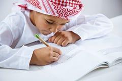 Arabic little boy doing homework Stock Photo