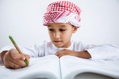 Arabic little boy doing homework Stock Photo