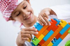Arabic little boy playing Stock Photos
