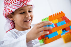 Arabic little boy playing. With toys Royalty Free Stock Image