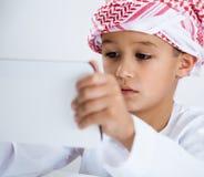 Arabic little boy using tablet Stock Image