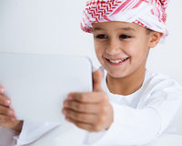Arabic little boy using tablet Royalty Free Stock Image