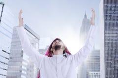 Arabic man praying in the city Royalty Free Stock Photo