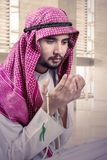 Arabic man praying in the mosque Royalty Free Stock Image