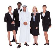 Arabic Man Standing With Businesspeople Royalty Free Stock Image