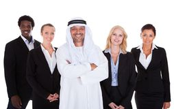 Arabic man standing with businesspeople Stock Image