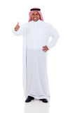 Arabic man thumb up. Cheerful arabic man giving thumb up on white background Royalty Free Stock Photography