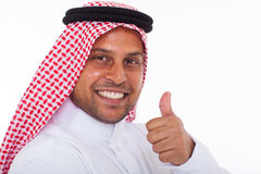 Arabic man thumb up. Happy arabic man giving thumb up on white background Royalty Free Stock Image
