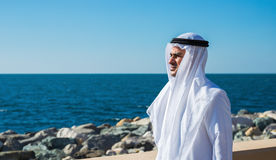 Arabic man is on the waterfront Stock Photos