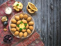Arabic meat appetizer Kibbeh. Traditional Arabic kibbeh with lamb and pine nuts stock photos