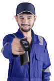 Arabic mechanic giving a car key Stock Image