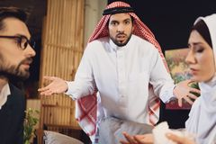 Arabic man confused at psychotherapist reception. stock photography
