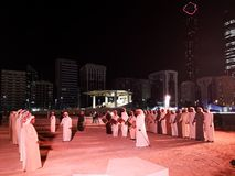 Arabic Middle Eastern men performing a traditional dance in Abu Dhabi, UAE at night stock image