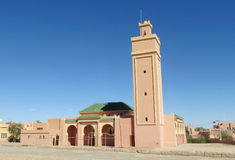 Arabic mosque. In Rissani, Morocco. Mosaic decoration on the wall. Square minara tower, pink walls Stock Photo