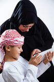 Arabic mother and her son using digital tablet Stock Photography