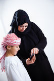 Arabic mother and her son using smart phone Stock Image