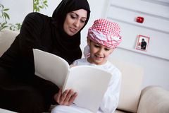 Arabic Mother And Son Reading A Book Royalty Free Stock Image