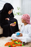Arabic mother and son together at home playing with toys. Stock Image