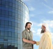 Arabic Muslim businessman meeting outdoors stock images