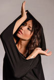 Arabic Muslim girl wearing black robe Stock Photo