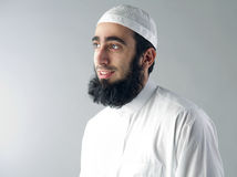 Arabic Muslim man with beard smiling Stock Photos