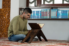Arabic Muslim Man Reading Holy Islamic Book Koran Royalty Free Stock Photography