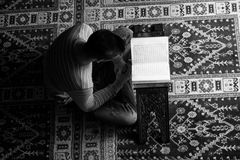 Arabic Muslim Man Reading Holy Islamic Book Koran Stock Images