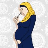 Arabic muslim pregnant woman in hijab prepared for maternity. Royalty Free Stock Photo
