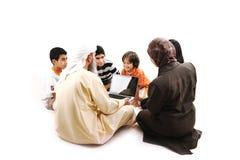 Arabic Muslim teacher with children stock images