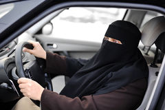 Arabic Muslim woman driving Stock Photo