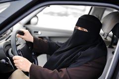 Arabic Muslim woman driving. A car Stock Photo
