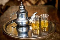 Arabic nana mint tea with metal tea pot and glasses Royalty Free Stock Photos