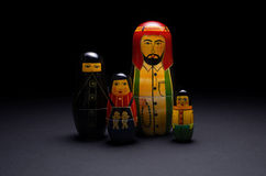 Arabic nesting dolls. A family of wooden arabic nesting dolls standing in a group. Photographed against a black background Royalty Free Stock Photos