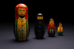 Arabic nesting dolls. A family of wooden arabic nesting dolls standing side by side. Photographed against a black background Royalty Free Stock Photography