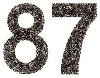 Arabic numeral 87, eighty seven, from black a natural charcoal, Stock Photos