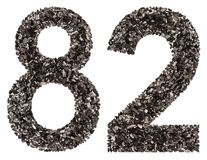 Arabic numeral 82, eighty two, from black a natural charcoal, is Stock Image
