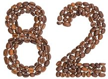 Arabic numeral 82, eighty two, from coffee beans, isolated on wh. Ite background Royalty Free Stock Photo