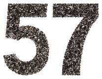 Arabic numeral 57, fifty seven, from black a natural charcoal, i Stock Photography