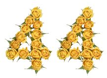 Arabic numeral 44, forty four, from yellow flowers of rose, isolated on white background.  stock photos