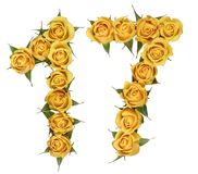 Arabic numeral 17, seventeen, from yellow flowers of rose, isolated on white background.  royalty free stock image