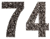 Arabic numeral 74, seventy four, from black a natural charcoal, Stock Image
