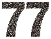 Arabic numeral 77, seventy seven, from black a natural charcoal, Stock Photography