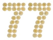 Arabic numeral 77, seventy seven, from cream flowers of chrysant. Hemum, isolated on white background Royalty Free Stock Photo