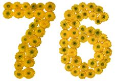 Arabic numeral 76, seventy six, from yellow flowers of buttercup. Isolated on white background Stock Photography