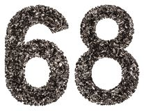 Arabic numeral 68, sixty eight, from black a natural charcoal, i Stock Images