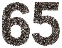 Arabic numeral 65, sixty five, from black a natural charcoal, is Royalty Free Stock Photos