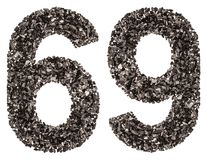Arabic numeral 69, sixty nine, from black a natural charcoal, is Royalty Free Stock Photo